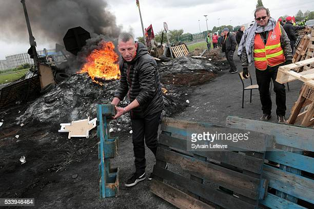 Strikers block access to the fuel depot of Haulchain near Valenciennes Northern France to protest against labour and employment law reforms on May 24...