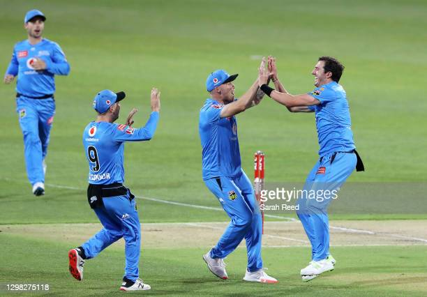 Strikers Daniel Worrall celebrates the wicket of Usman Khawaja of the Thunder with team mates Phil Salt of the Strikers bowled for a duck during the...