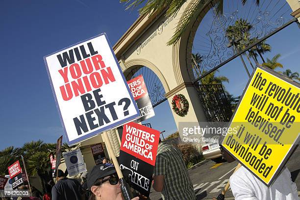 Strikers march at the Writer's Guild of America's 'Diversity Day' at Paramount Pictures studio on December 12 2007 in Los Angeles California