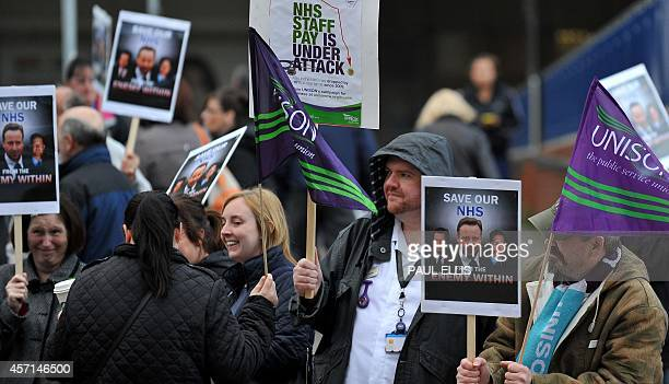 Strikers outside the Royal Liverpool Hospital in Liverpool north west England on October 2014 Workers in England's staterun National Health Service...