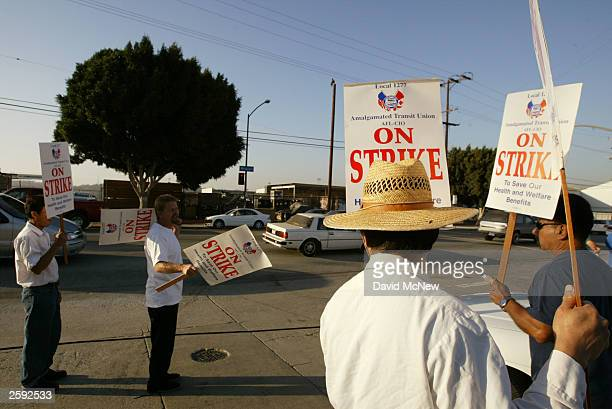 Strikers picket in front of the Operating Division 10 bus facility on October 14, 2003 in Los Angeles, California. Some 2,000 Amalgamated Transit...