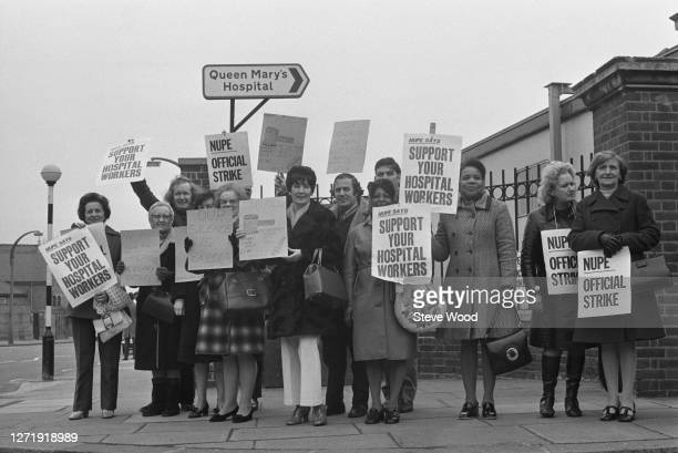 Strikers picketing Queen Mary's Hospital, Roehampton, in support of ancillary hospital workers during a period of industrial action, London, 1st...