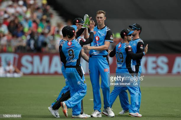 Strikers players celebrate a wicket during the Big Bash League match between the Sydney Thunder and the Adelaide Strikers at Spotless Stadium on...
