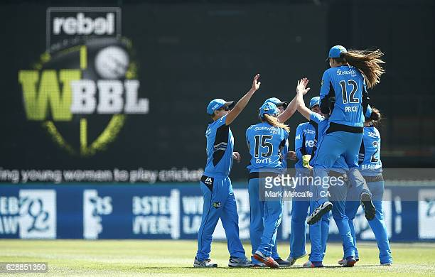 'SYDNEY AUSTRALIA DECEMBER 10 Strikers players celebrate taking the wicket of Grace Harris of the Renegades during the Women's Big Bash League match...