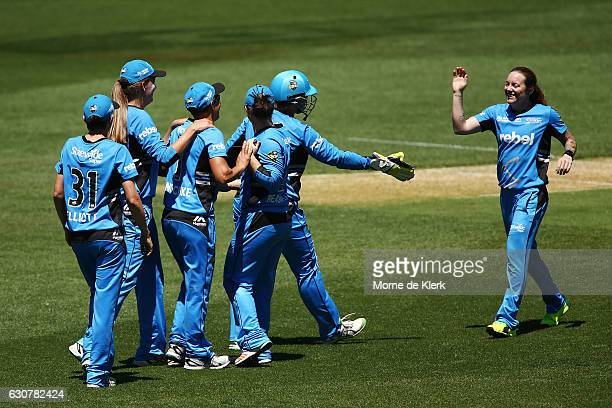 Strikers players celebrate with Sarah Coyte of the Adelaide Strikers after she got the wicket of Ashleigh Gardner of the Sydney Sixers during the...