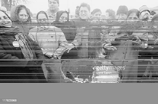 Strikers warm themselves by a brazier on the picket line during a strike by domestic workers at Hillingdon Hospital London England United Kingdom in...