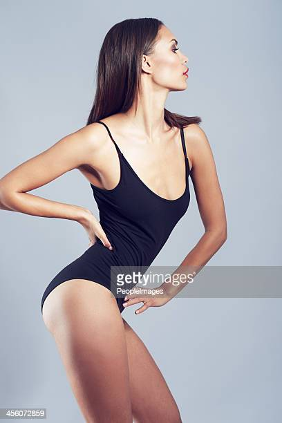 striking a pose - leotard stock photos and pictures