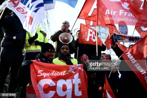 Striking Air France employees hold flags of French union CGT at Charles de Gaulle airport in Roissy outside Paris on February 22 2018 Half of Air...
