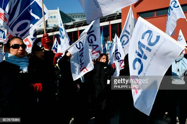 Striking Air France employees hold flags of the SNGAF union at Charles de Gaulle airport in Roissy, outside Paris, on February 22, 2018. Half of Air...