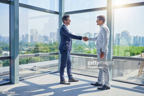 striking big deals together - brazilian men stock photos and pictures