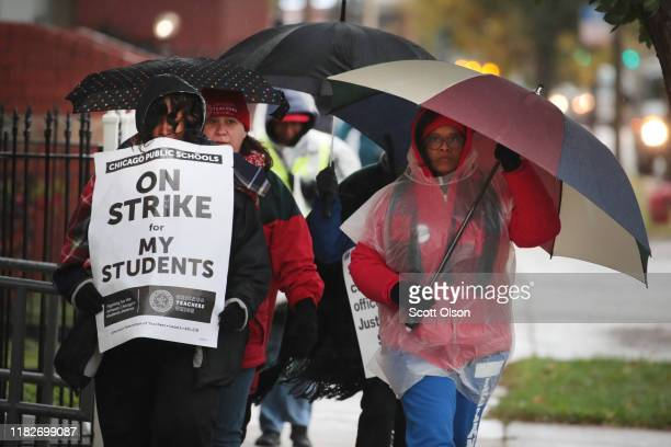 Striking Chicago teachers and their supporters picket outside of Oscar DePriest Elementary School on October 22, 2019 in Chicago, Illinois. About...