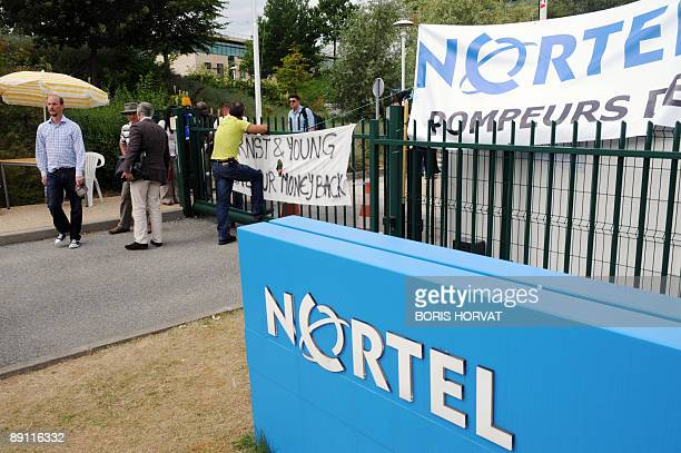Striking employees of Nortel France, a subsidiary of the Canadian telecommunications firm Nortel, gather in front of the entrance of the factory...