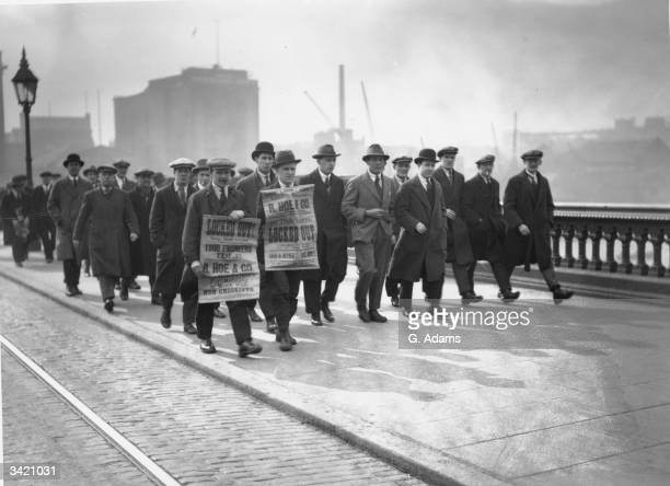Striking engineers crossing Blackfriars Bridge London on a march to Memorial Hall