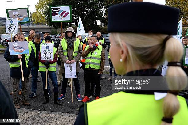 Striking flight crews from airliners Eurowings and Germanwings gather during a one-day strike outside the Eurowings and Germanwings corporate...