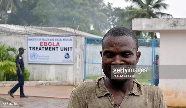 Striking healthcare personnel spokesperson Alphonso Wesseh poses on October 11 2014 outside the recently opened Ebola Island Clinic in Monrovia...