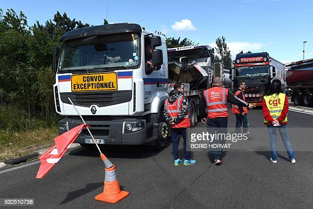 Striking lorries drivers block the road to protest against the controversial labour reform bill on May 19 2016 on the D568 departmental road near...