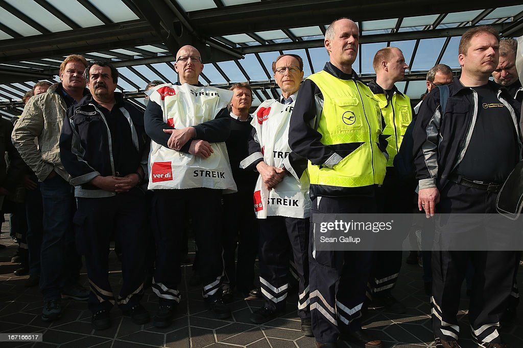 Striking Lufthansa employees gather at Tegel Airport during a nationwide strike by Lufthansa ground, service and maintenance personnel on April 22, 2013 in Berlin, Germany. Workers are demanding pay raises and job guarantees and today's strike has forced Lufthansa to cancel approximately 1700 flights.