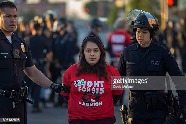 Striking McDonald's restaurant employees are arrested while sitting in an intersection after walking off the job to demand a $15 per hour wage and...