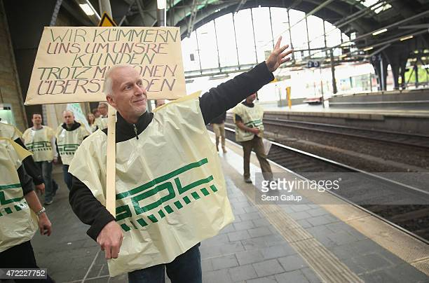 Striking members of the GDL train drivers' union stroll through Ostbahnhof train station on the first full day of their weeklong strike against...