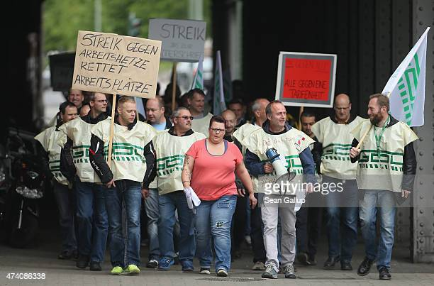 Striking members of the GDL train engineers' labor union walk outside Ostbahnhof railway station during the first full day of a railway strike by the...