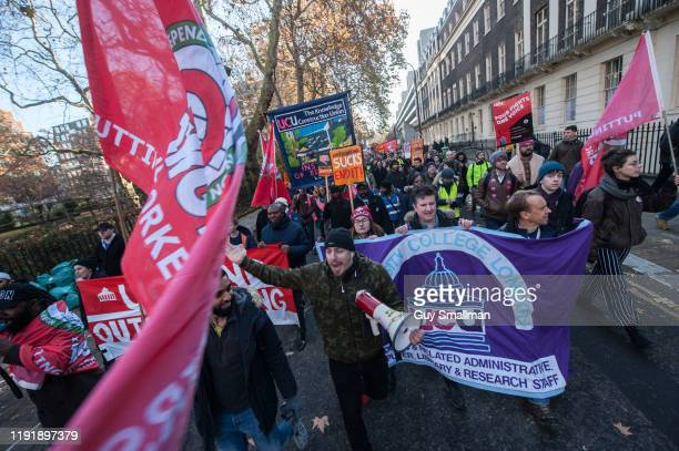 Striking members of the UCU and IWGB at UCL march together towards the headquarters of UUK on December 4 2019 in London England Striking members of...