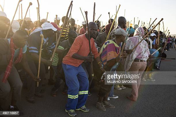 Striking miners demonstrate in Marikana 40 kms away from Rustenburg in the South African platinum belt on May 13 2014 Three mine workers were killed...