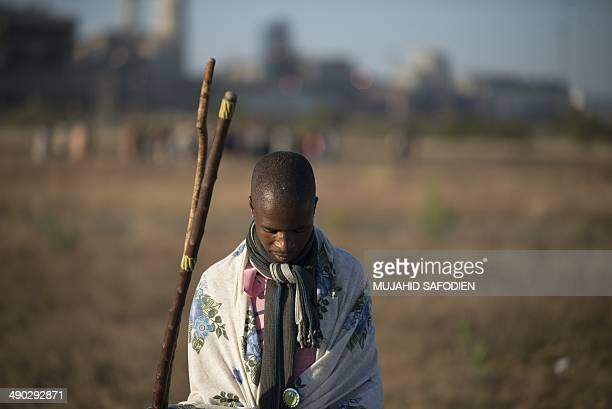 Striking miners march in Marikana 40 kms from Rustenburg in the South African platinum belt on May 14 2014 Hundreds of striking miners marched at a...