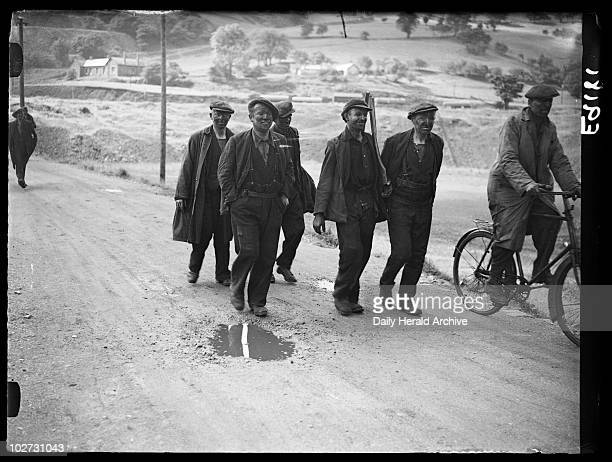 Striking miners returning to their homes Wales 6 September 1936 A photograph of smiling miners returning to their homes in Bedwas Wales following...