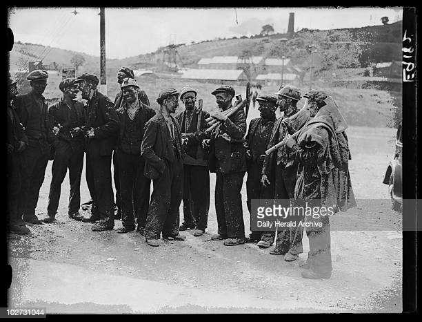 Striking miners returning to their homes Wales 6 September 1936 A photograph of miners gathering in the street to chat before returning to their...