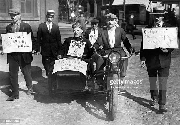 Striking moving van drivers and teamsters picket a Harlem warehouse New York New York September 15 1920 They want $6 for an 8 hour day