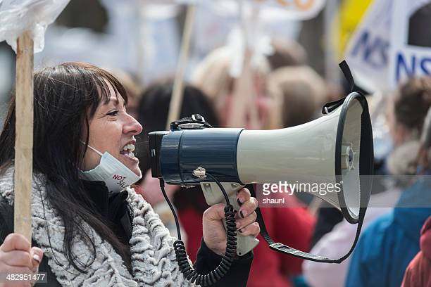 striking nsgeu nurse with megaphone - striker stock pictures, royalty-free photos & images