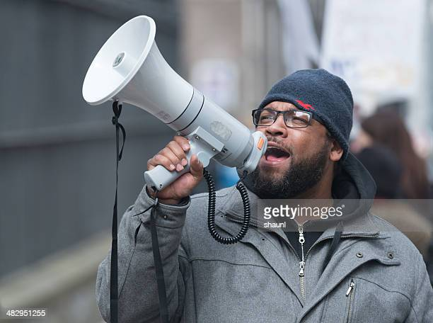 nsgeu striking nurse with megaphone - labor union stock pictures, royalty-free photos & images