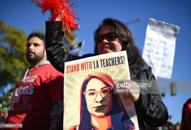 Striking public school teachers and their supporters march during the 34th annual Kingdom Day Parade on Martin Luther King Jr Day January 21 in Los...