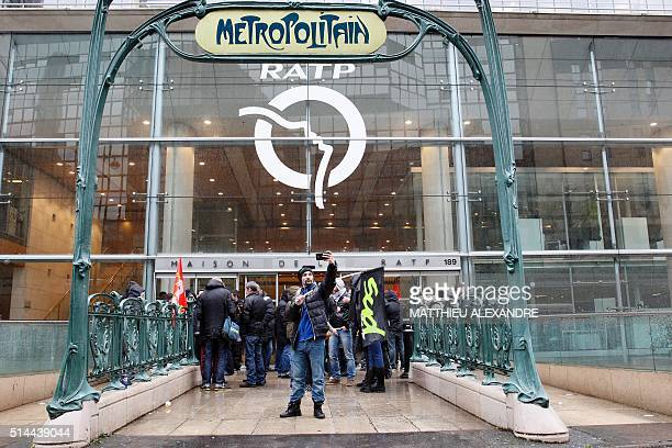 TOPSHOT Striking rail workers demonstrate to call for better work conditions in front of the headquarters of the RATP on March 9 2016 in Paris as...