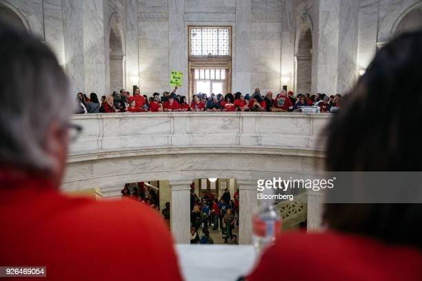 Striking school workers hold sign inside the West Virginia Capitol in Charleston West Virginia US on Friday March 2 2018 A week ago thousands of...