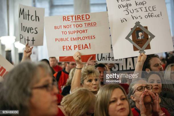Striking school workers hold signs and chant inside the West Virginia Capitol in Charleston West Virginia US on Friday March 2 2018 A week ago...