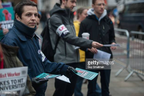 Striking staff members and their student supporters on the picket line at University College Hospital in Central London on November 25, 2019 in...