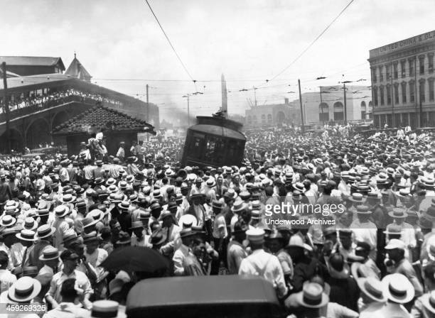 20000 striking street car workers and sympathizers on Canal Street just before they burned the street car that the Public Service Company had...