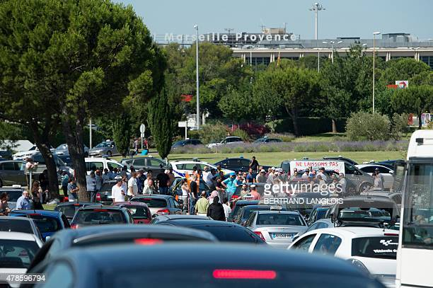 Striking taxi drivers block access to the Marignane airport near Marseille, southern France, on June 26, 2015. Hundreds of taxi drivers converged on...