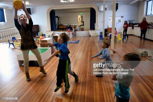 Striking teacher and volunteer JoAnne Rizzi an enrichment teacher at Edison Elementary plays ball with children at Highlands United Methodist Church...