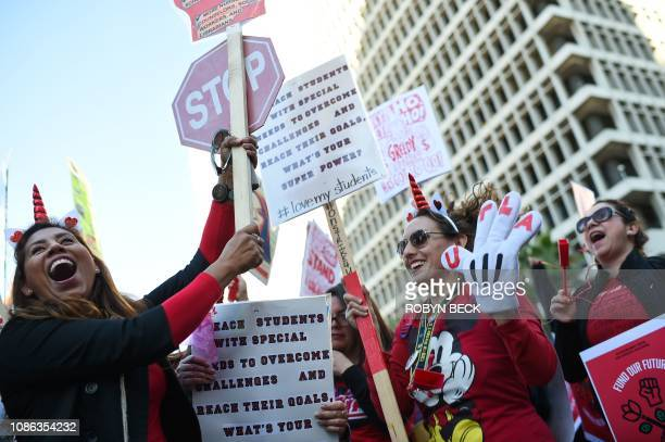 Striking teachers cheer on January 22 in Los Angeles, as the teacher's union reached a tentative deal with the Los Angeles Unified School District. -...