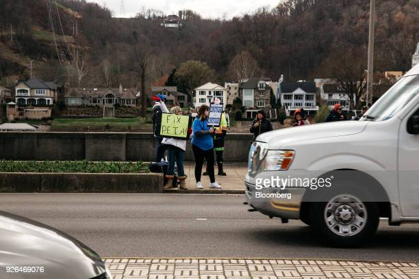 Striking teachers stand on a small picket line outside the West Virginia Capitol in Charleston West Virginia US on Friday March 2 2018 A week ago...