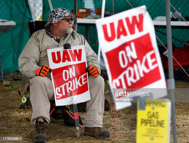 A striking United Auto Workers member pickets at the General Motors Lansing Delta Assembly plant for the fifth week of the strike on October 16 2019...