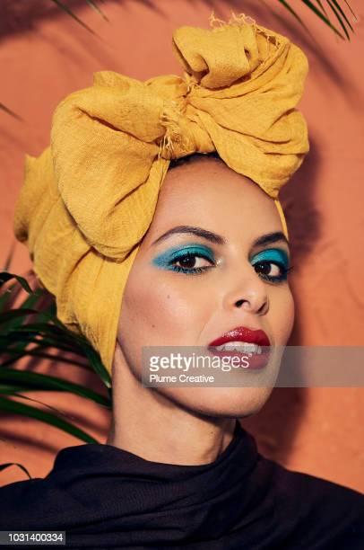 Striking woman in yellow hijab