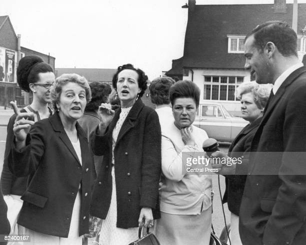 Striking women machinists from the Ford plant at Dagenham are interviewed upon their arrival at Rainham for a meeting with the National Union of...