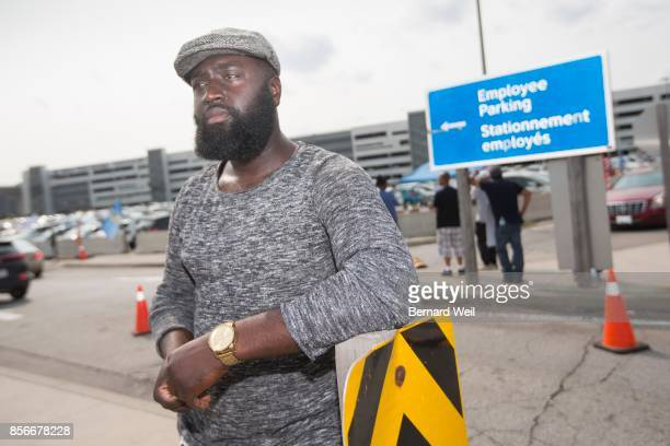 TORONTO ON SEPTEMBER 15 Striking worker Henry Appiah stands outside the employee entrance at a large parking lot across Viscount station where temps...