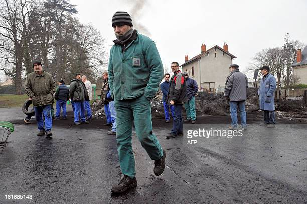 Striking workers of the DMI foundry of Vaux, gone into receivership, are gathered on February 14, 2013 in front of the plant in Vaux, as they occupy...
