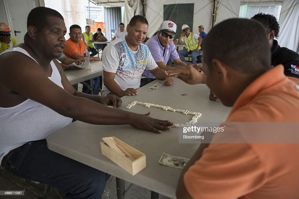 Striking workers play dominoes in a tent at the construction site for the third sets of locks on the Pacific side of the Panama Canal near Panama City, Panama, on Thursday, April 24, 2014. Panama's presidential contenders are winding down their campaigns ahead of the May 4 election as a strike by construction workers paralyzes the expansion of the country's signature waterway, its biggest economic resource. Photographer: Susana Gonzalez/Bloomberg via Getty Images