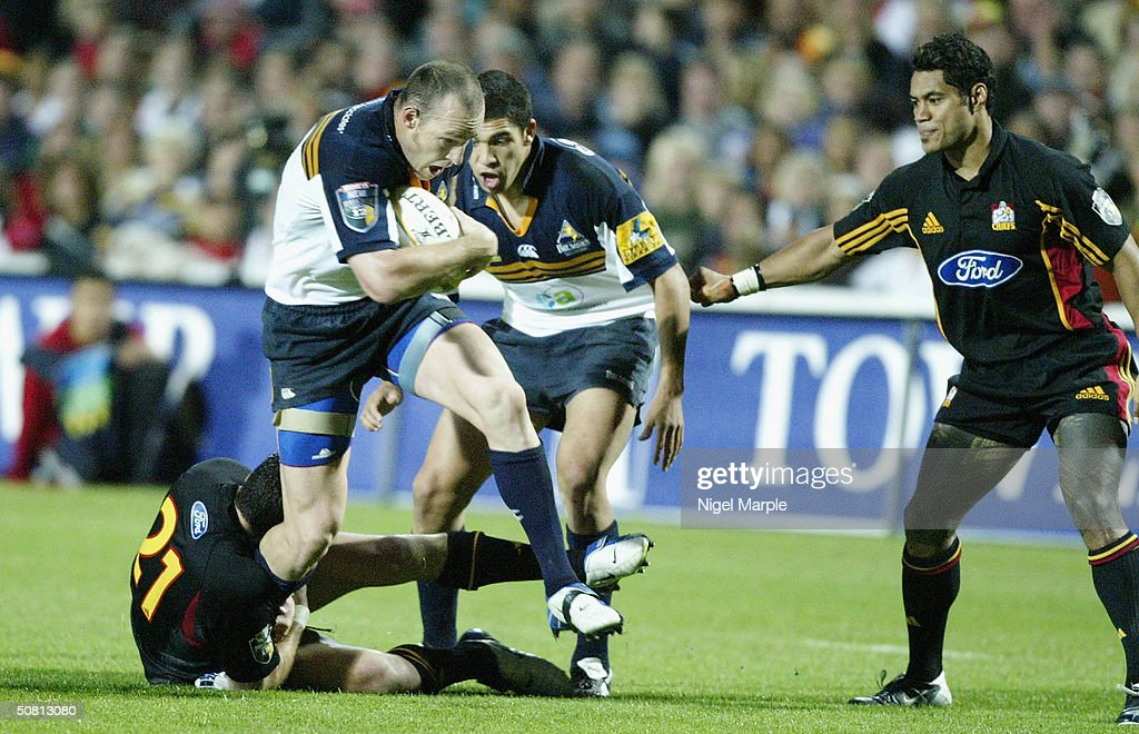 Striling Mortlock #13 of the Brumbies in action during the Super 12 game between the Chiefs and Brumbies at Waikato Stadium in Hamilton, New Zealand on May 8, 2004. The Chiefs scored a point by finishing within 8 points of the Brumbies to go through. The Brumbies won the match 15-12.