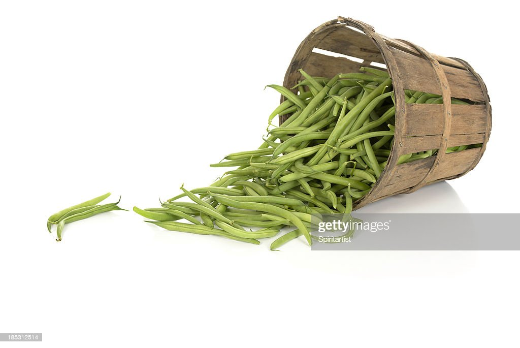 String Beans in a Tipped Rustic Basket : Stock Photo